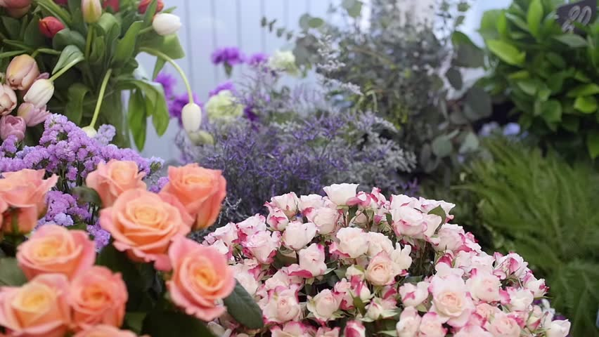 Florist Prepares A Bouquet Of Flowers For Sale To Customers In Love Floral Design
