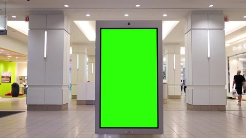 Burnaby, BC, Canada - May 04, 2017 : Motion of people shopping and green screen billboard in the middle inside Burnaby shopping mall with 4k resolution