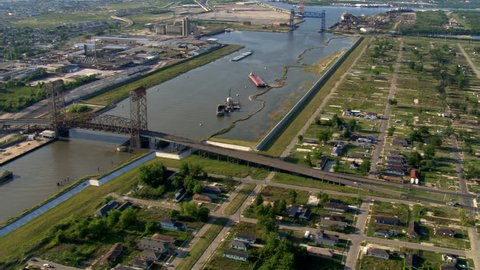 Flight paralleling canal beside Katrina-damaged lots in New Orleans. Shot in 2007.