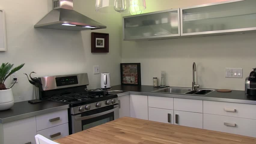 Furniture Design Videos interior of modern kitchen with beige furniture and stove stock