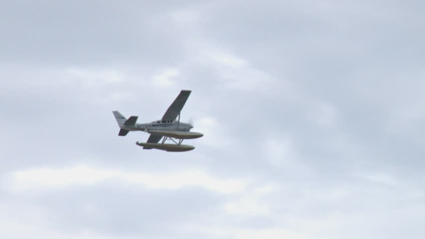 seaplane flying through clouds