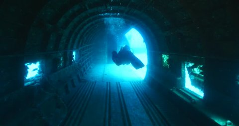 scuba diver in airplane wreck underwater diving