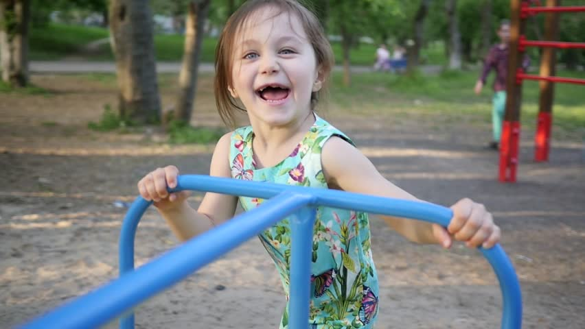Active Little Child Girl Play On Park Playground Running With A Carousel Slow Motion