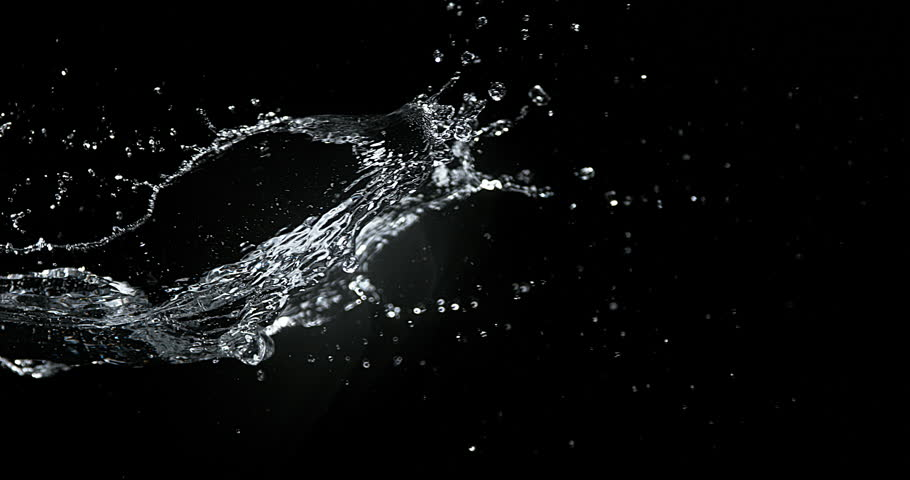 Water spurting out against Black Background, Slow motion 4K