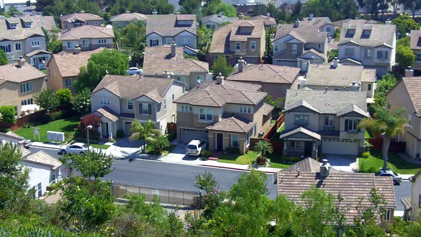 A high angle view of new suburban homes on a residential street in the suburbs