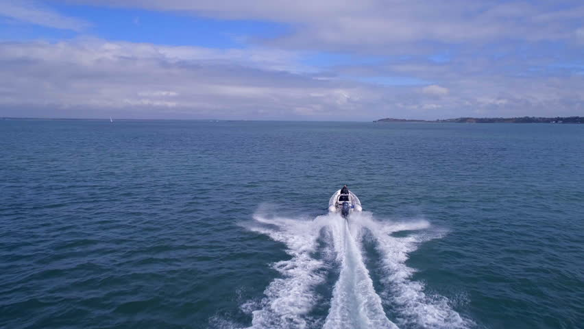 A Powerboat Travelling Through the Water at High Speed