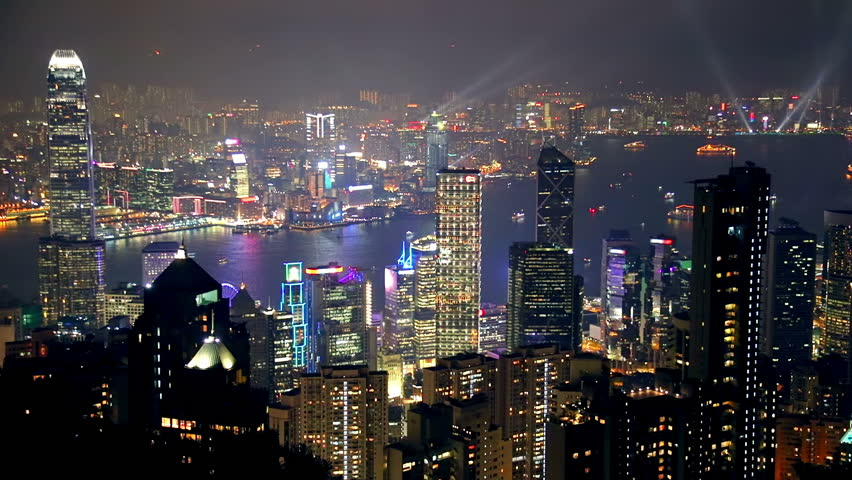 China. Night in Hong Kong City from height of bird's flight. The life of the city and light show.