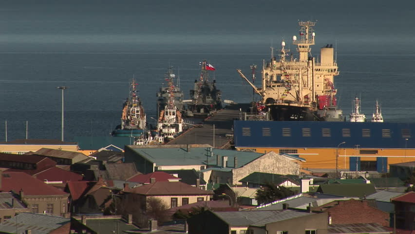 Boats docked at a seaport in Punta Arenas, Chile