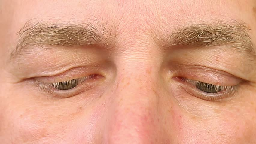 f0b09437ffc Sleeping adult man open his eyes. Extreme close-up view. Human eyes fast  open up. REM rapid eye movement. See dreams sleep and wake up rapidly.