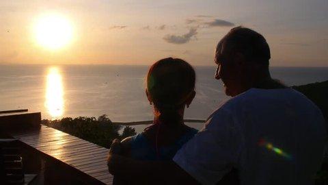 Senior Couple Enjoying Sunset Over Sea on Summer Holidays. Slow Motion. HD, 1920x1080.