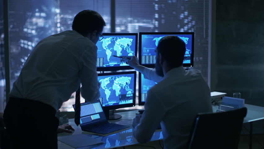 Late at Night in Office Building Security Service Men Have Discussion while Attentively Observing Monitors with Location Sensitive Information Shown on Them.  | Shutterstock HD Video #26897101
