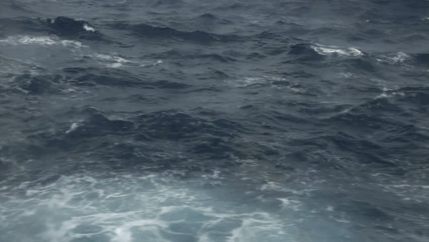 Cruising by rough ocean waves
