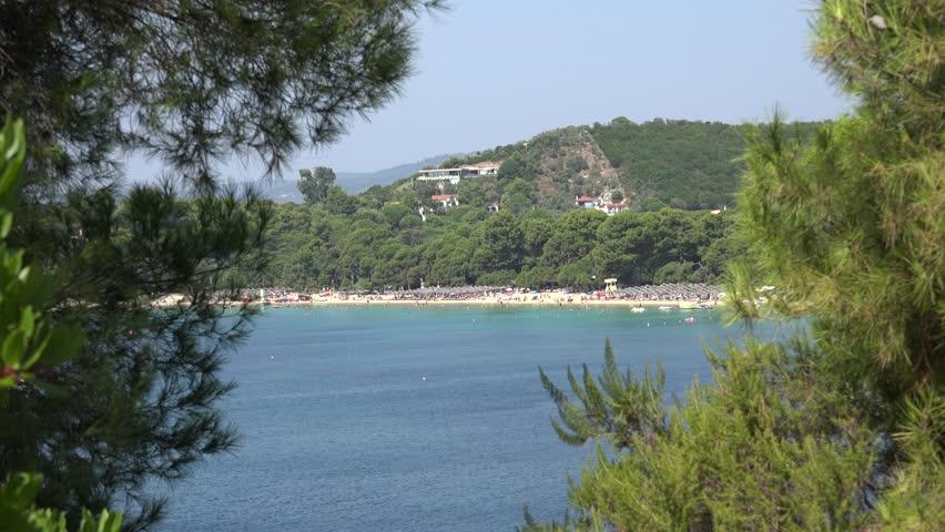 4K Aerial view of famous Koukounaries beach in Skiathos island, exotic honeymoon day