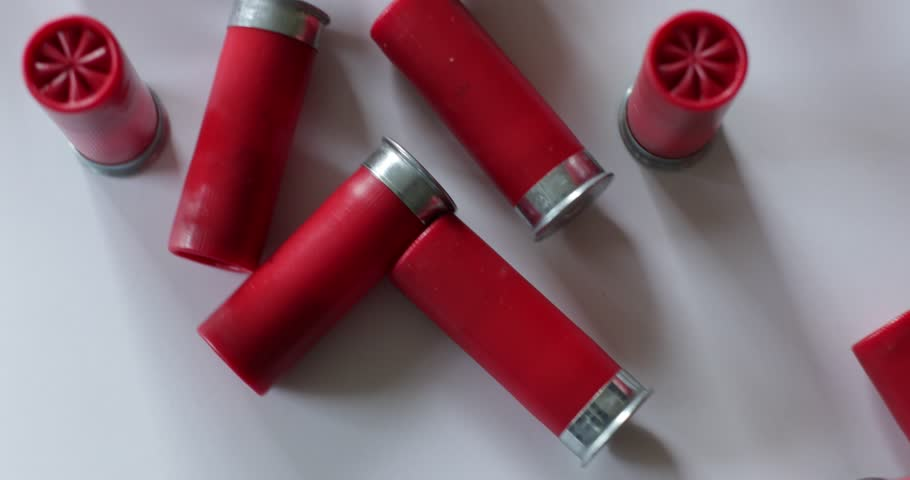 Shotgun shells scattered on white surface | Shutterstock HD Video #26958301
