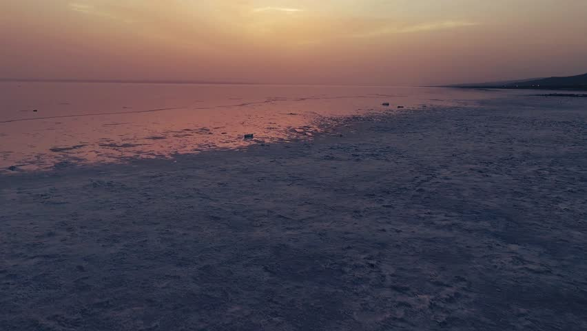 Sunset at salt lake Turkey. sunrise reflection on salt flat covered with water and clouds. Image taken with drone