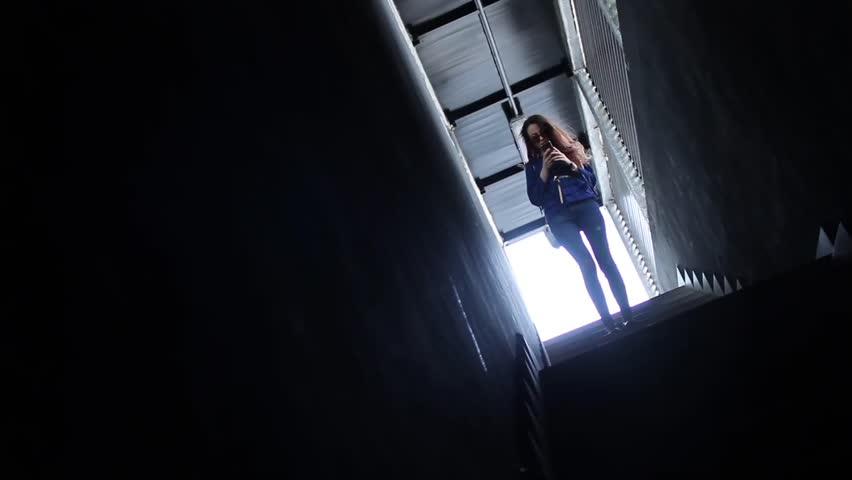 Young woman standing on stairs and using smartphone | Shutterstock HD Video #27111151