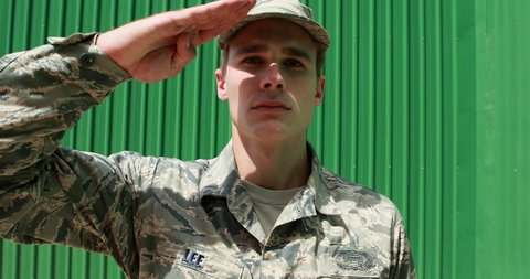Portrait of military soldier saluting at boot camp