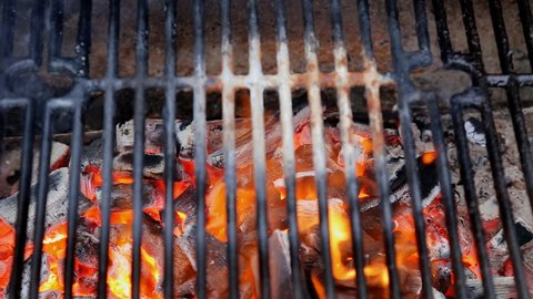 Empty Hot Charcoal Barbecue Grill With Bright Flame