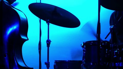Silhouette of a jazz band playing in a nightclub. Blue backlight.