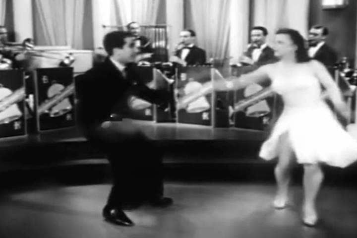 1940s: A man and woman perform some amazing swing dancing in this 1940s soundie musical.