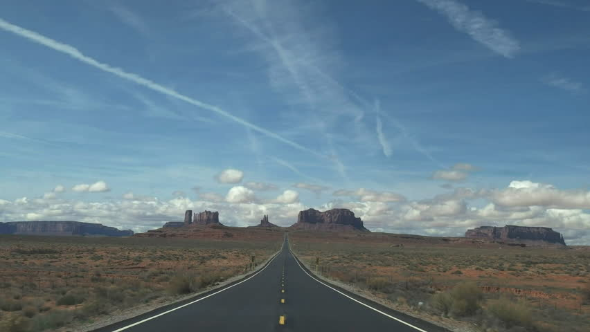 a wide angle shot driving on hwy 163 towards monument valley in utah, usa