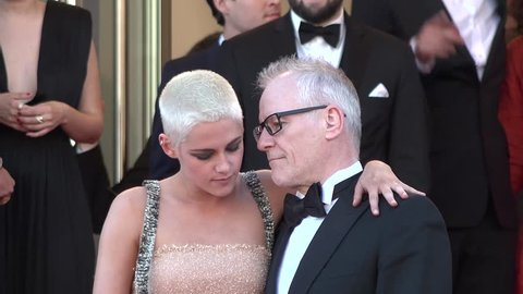 Kristen Stewart with Festival President Thierry Frémaux at the Cannes Film Festival, 5/20/2017