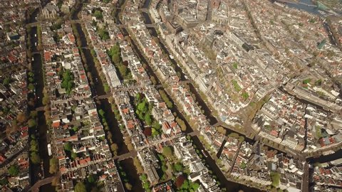 Aerial of Amsterdam, with its canals and old mansions. Highlights the center Prinsengracht, Herengracht, Keizersgracht and in the background the IJ and the Central Station.