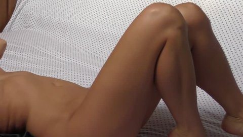 close up nude girl in bed