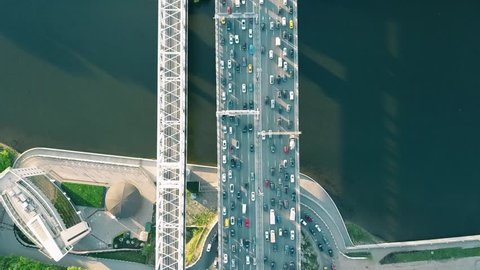 Aerial top down view shot of traffic jam on a car bridge in the evening rush hour. 4K video