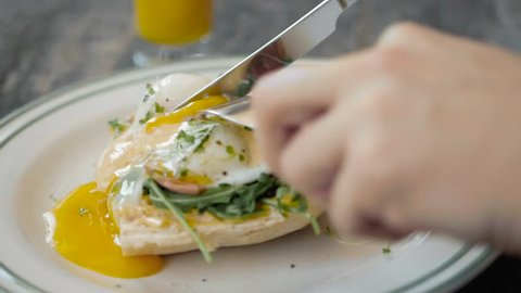 Eggs Benedict with bread and tomato on a plate with becon morning sandwich
