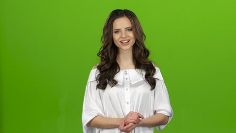 TV presenter is reporting and tells a lot of interesting news. Green screen