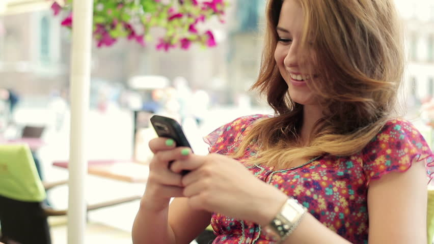 Happy young woman using smartphone in the city | Shutterstock HD Video #2733755
