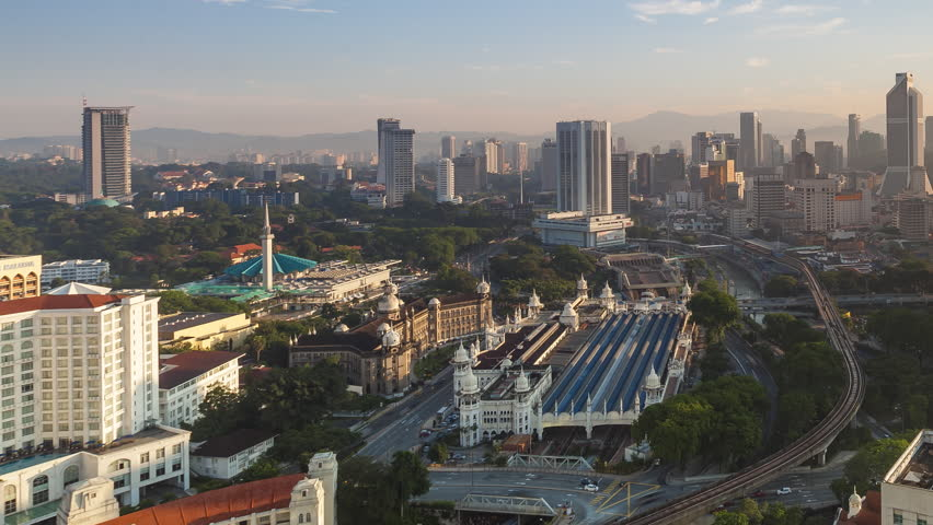 Time lapse 4k Footage of a beautiful morning At Kuala Lumpur, Malaysia overlooking the national heritages. Showing moving cars with trails and sun rays. | Shutterstock HD Video #27338011