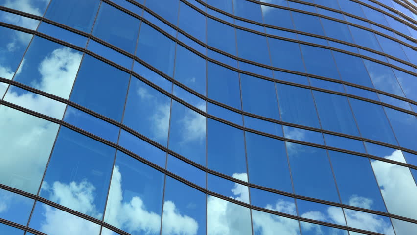 Timelapse of architectural glass feature reflects cloudscape and blue sky. #2735174