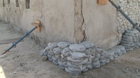 SHARJAH, UAE - CIRCA 2008: Tilt-up shot on support column holding up the walls of a building with sand bags in the partially reconstructed historical area, part of the cultural revival of Sharjah.