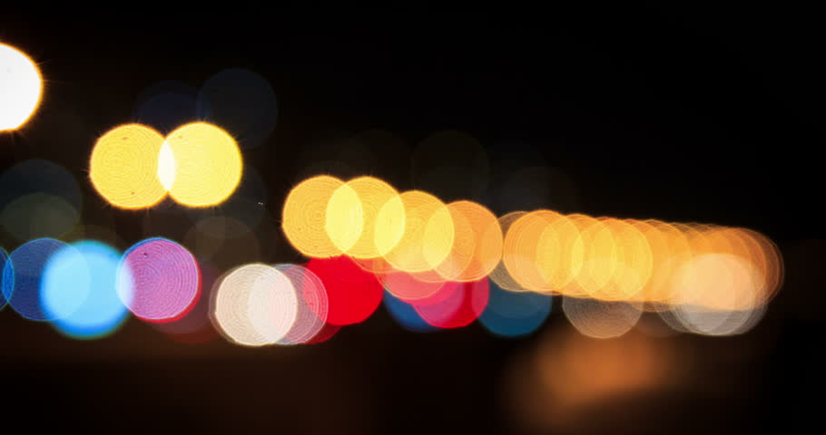 Time lapse of city and traffic lights, Montevideo, Uruguay. Blue, green, red and yellow colors. Images defocused, taken at night.