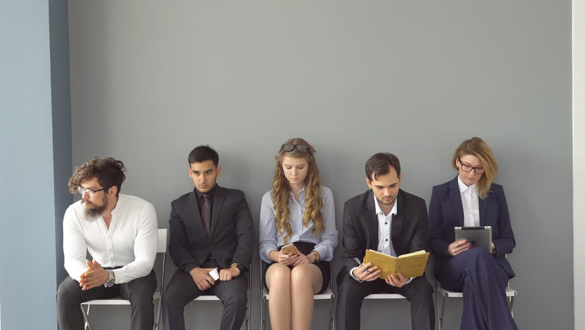young professionals on job interview. University graduates trying to find work. waiting in the lobby of an office building