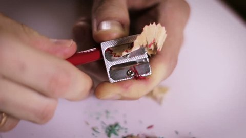 sharpening a pencil with sharpeners