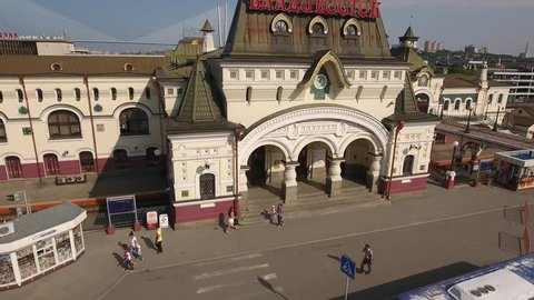 Entrance Vladivostok railway station ending of Trans-Siberian railway. Italian architecture. Aerial drone flight around. Downtown city tourist attraction. Beautiful summer Vladivostok