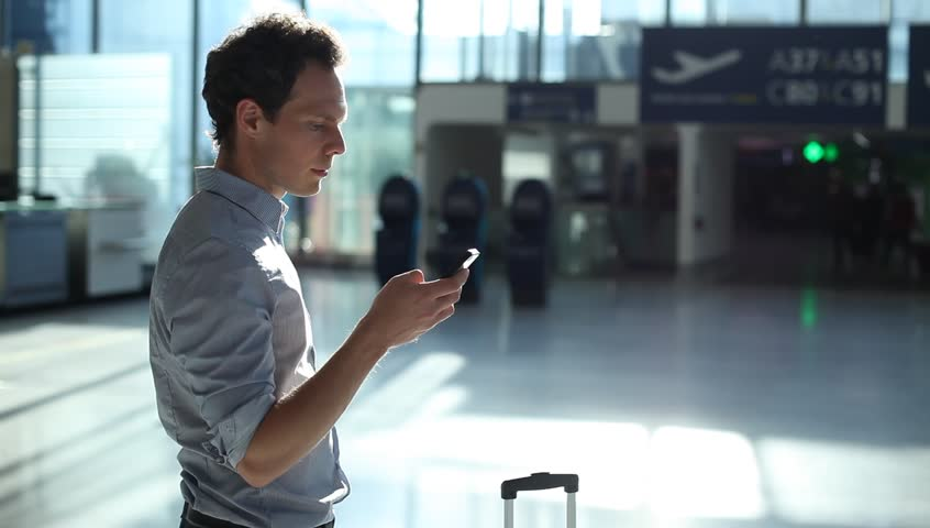 man using smartphone in the airport