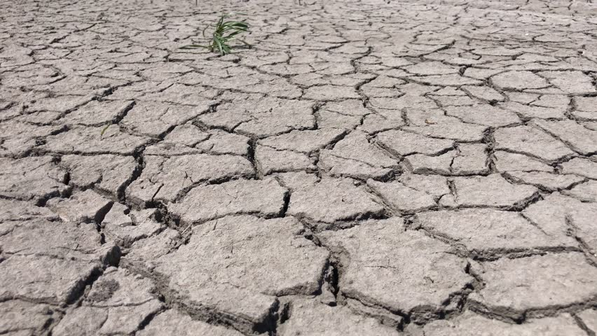 Dry lake bed with natural texture of cracked clay in perspective cracked by drought the ground view from above 4k stock footage clip sciox Images
