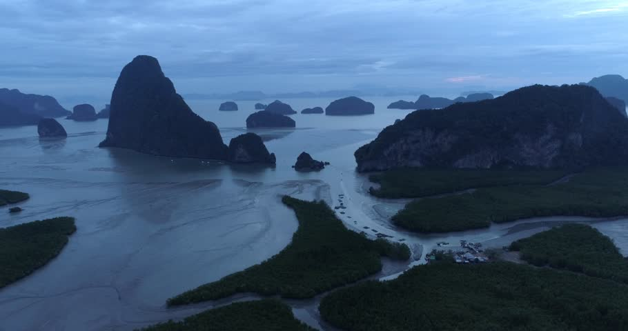 Drone flight video under many rocky islands in a calm Phang Nga bay at sunrise. Nature Park Phang-Nga, Thailand. 2017