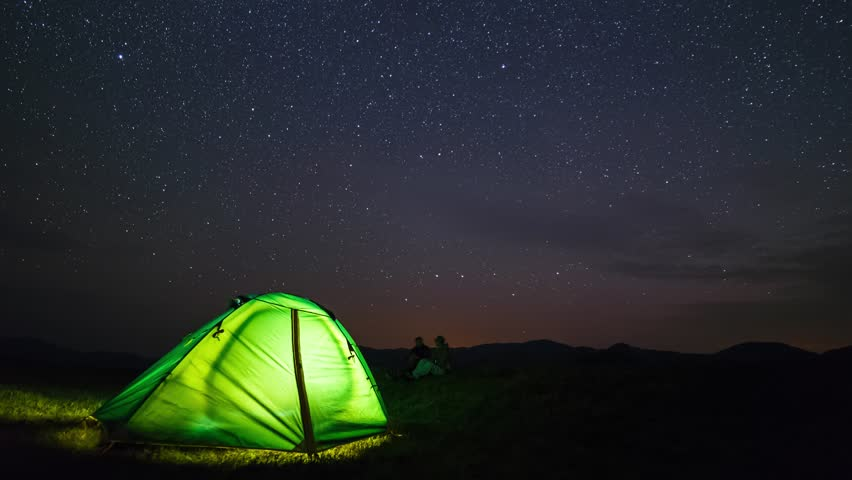 Two travelers watching the meteor shower in summer time. Timelapse of stars moving in night & Moving Stars Above Tent At Night Time Lapse Stock Footage Video ...