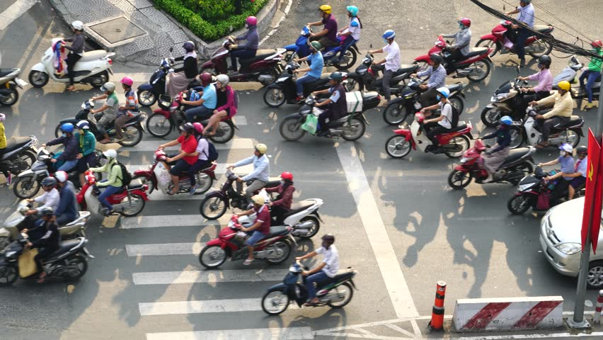 Ho Chi Minh City, Vietnam - April 2017 - Busy roads of Saigon, chaos on the street and above. | Shutterstock HD Video #27502891