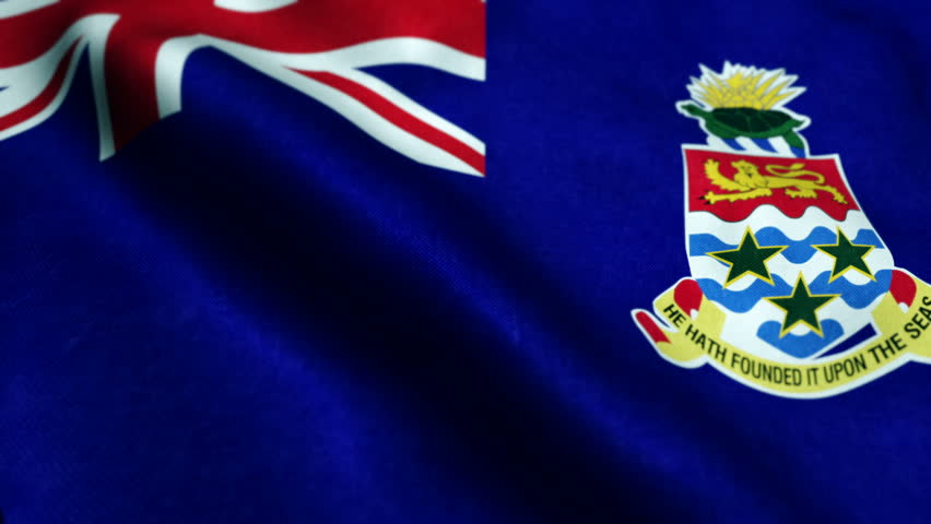 Flag of Cayman Islands waving on flagpole in the wind, national symbol of freedom. Traditional flag symbolizing the pride of nation, love for motherland - Seamless Looping