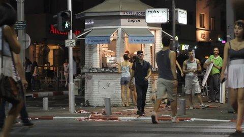 TEL-AVIV - Summer 2012: young people cross the street in Rothschild avenue during white night festival in Tel-Aviv, summer 2012