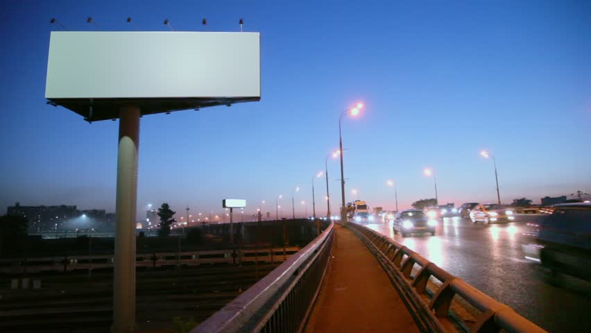 Empty advertising billboard on sidelines of road with traffic near railroad at evening, fast motion time lapse #2760914