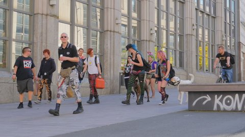 LUBECK, GERMANY - MAY 28: Punks walking on pedestrianized street on May 28, 2017 in Lubeck, Germany. Subculture. Everyday routine life in Europe.