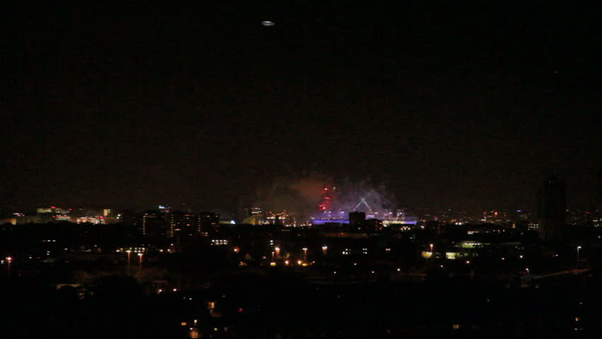 Olympic 2012 closing ceremony with London silhouetted and fireworks with air balloon