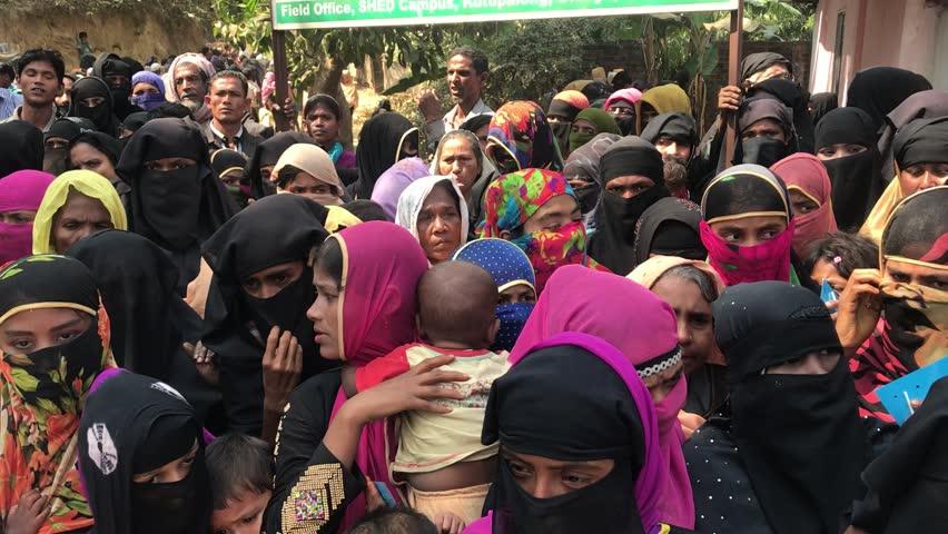 TEKNAF, BANGLADESH - APRIL 1, 2017 : Rohingya refugees from Myanmar waiting for food aid in Kutupalong refugee camp near Cox's Bazar, Bangladesh.